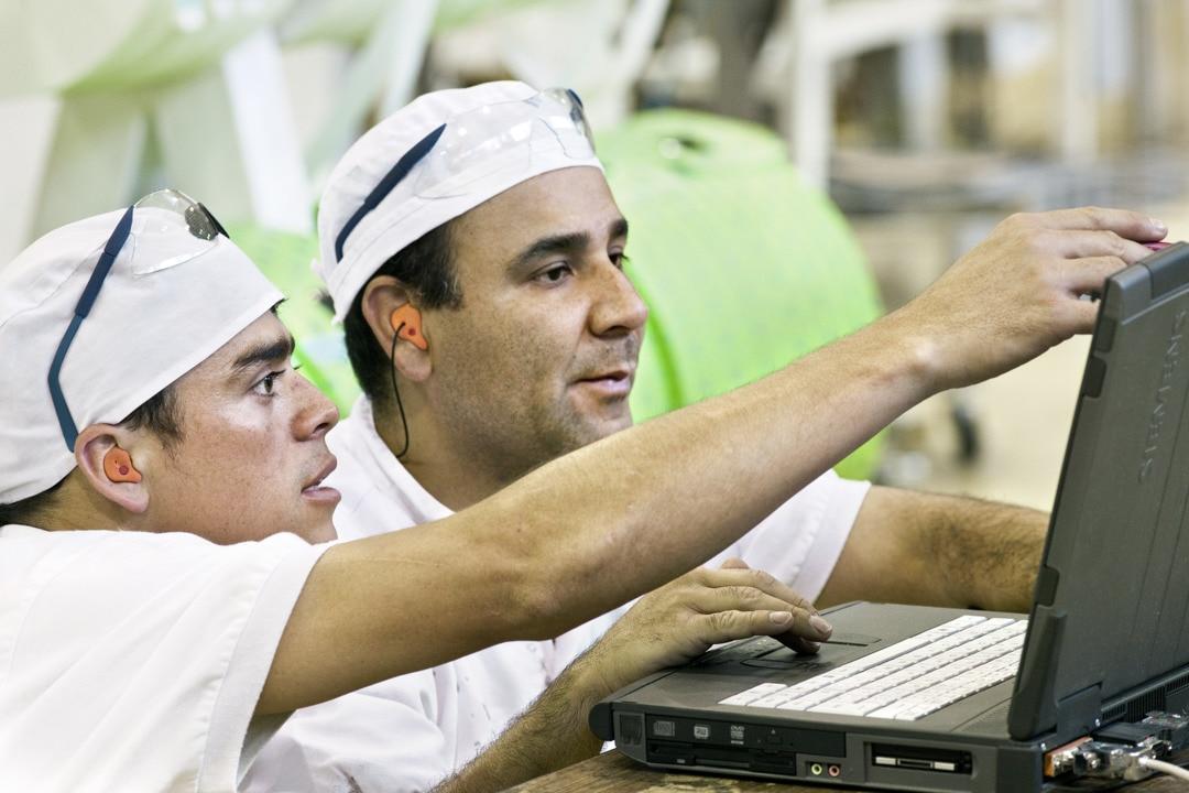 Working men in factory